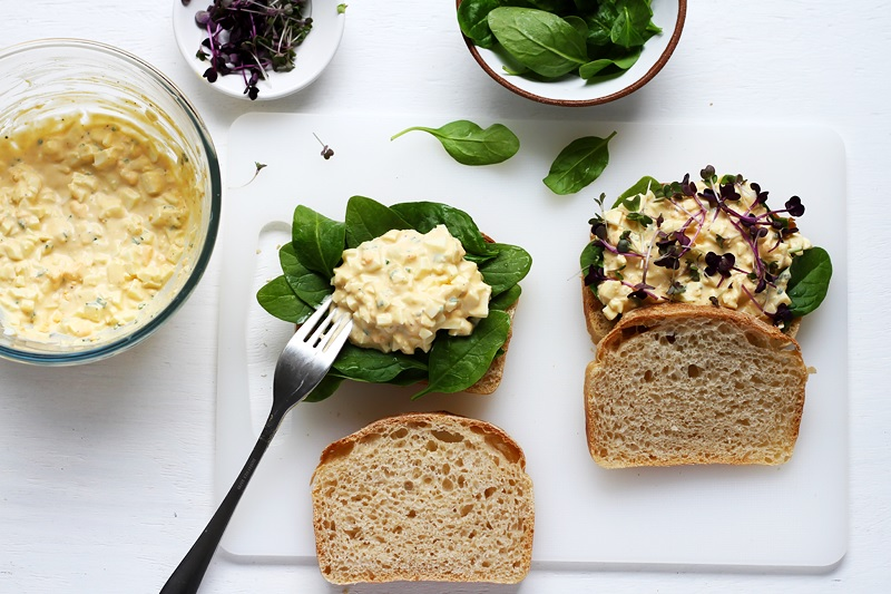 Assembling the best egg salad sandwich