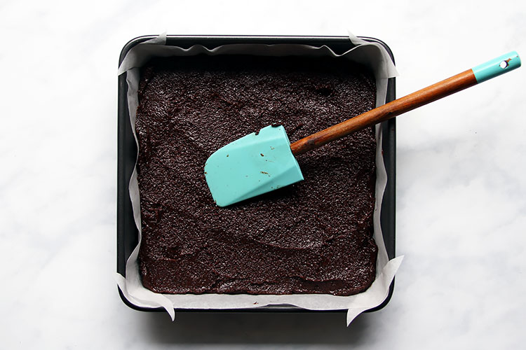 Spreading poppy seed batter in pan