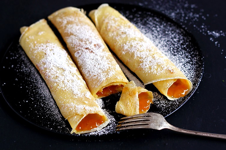 Crepes filled with apricot jam Palatschinken recipe