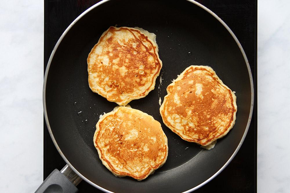 Flipped banana pancakes in pan