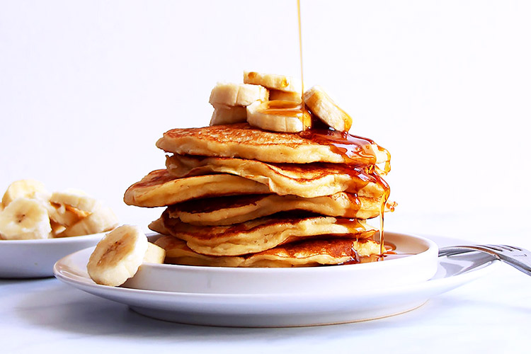 Stack of pancakes drizzled with syrup
