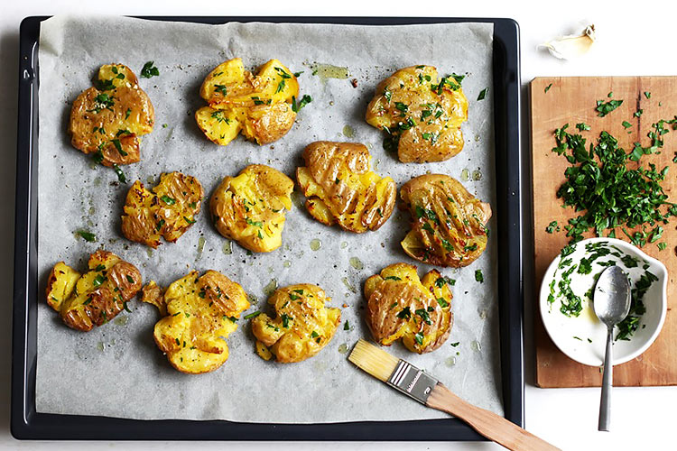 Garlic and herbs for crispy smashed potatoes