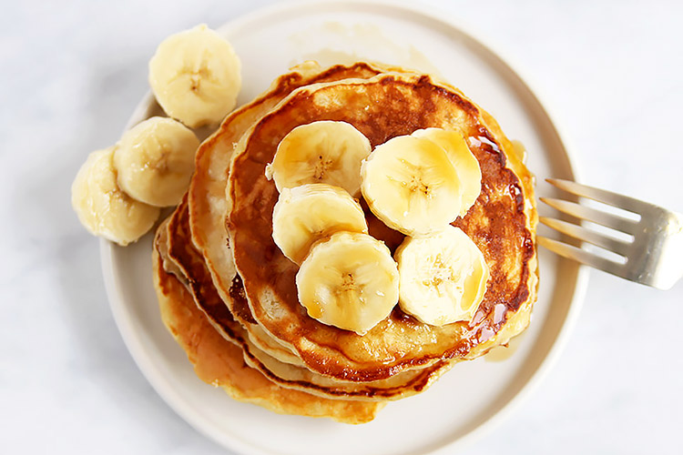 Pancakes topped with banana slices