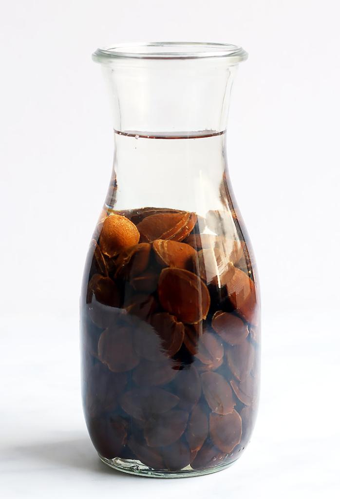 Homemade Amaretto Liqueur recipe with apricot pits