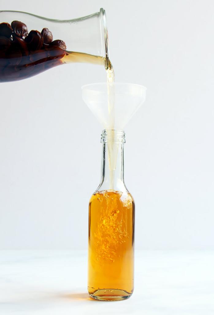 Homemade recipe amaretto liqueur with apricot stones